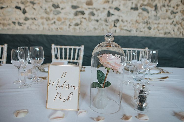 Gold Foil Wedding Stationery Table Name Card | Single Rose Flower Stem Under a Cloche | Sleeping Beauty Inspired Centrepiece | Pastel Pink & Mint Green Wedding at Granary Estates Suffolk | Julia & You Photography