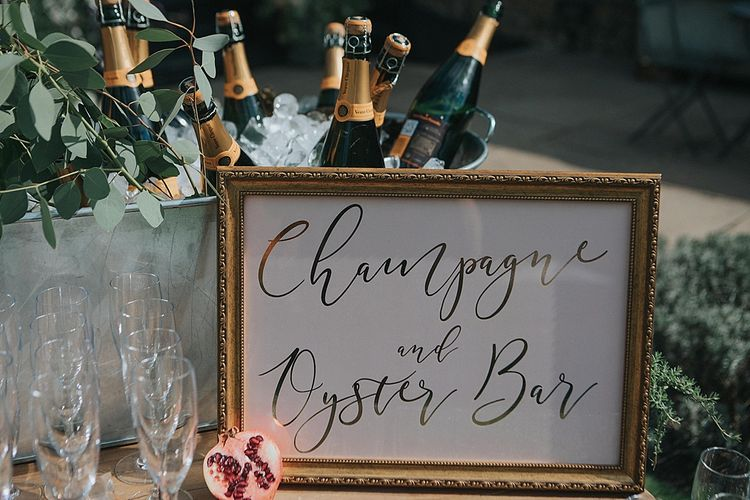 Gold Foil Champagne & Oyster Bar Wedding Sign | Pastel Pink & Mint Green Wedding at Granary Estates Suffolk | Julia & You Photography