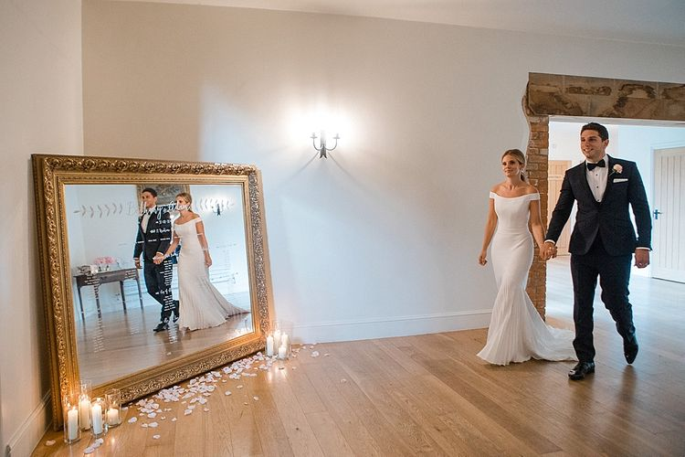 Giant Mirror Table Plan | Bride in Suzanne Neville Bardot Nouveau Wedding Dress | Groom in Black Tie | Pastel Pink & Mint Green Wedding at Granary Estates Suffolk | Julia & You Photography