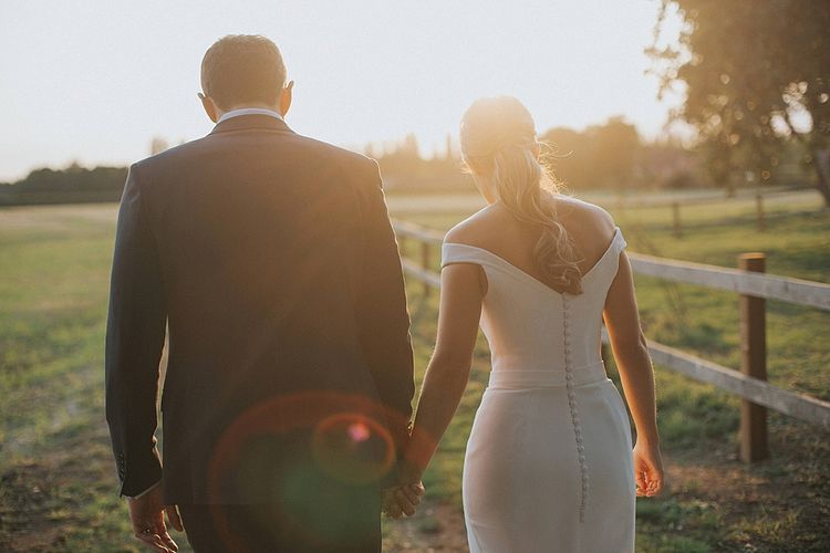 Golden Hour Portrait | Bride in Suzanne Neville Bardot Nouveau Wedding Dress | Groom in Black Tie | Pastel Pink & Mint Green Wedding at Granary Estates Suffolk | Julia & You Photography