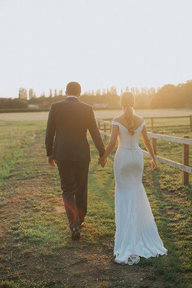 Sunset Portrait | Bride in Suzanne Neville Bardot Nouveau Wedding Dress | Groom in Black Tie | Pastel Pink & Mint Green Wedding at Granary Estates Suffolk | Julia & You Photography