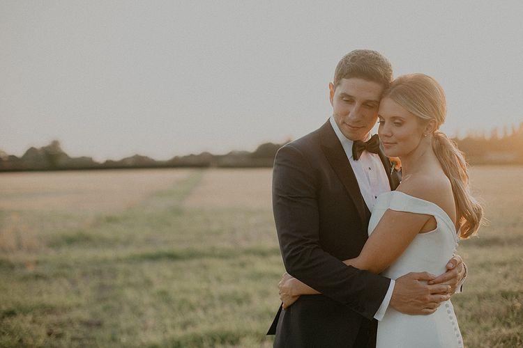 Bride in Suzanne Neville Bardot Nouveau Wedding Dress | Groom in Black Tie | Pastel Pink & Mint Green Wedding at Granary Estates Suffolk | Julia & You Photography