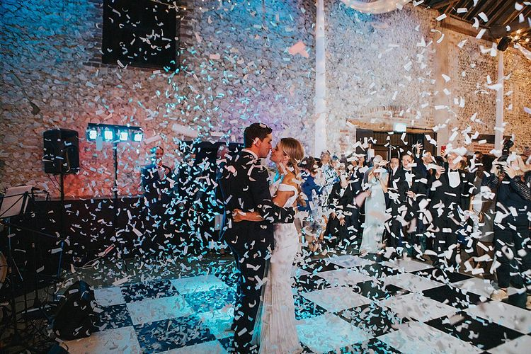 Confetti Cannon First Dance | Bride in Suzanne Neville Bardot Nouveau Wedding Dress | Groom in Black Tie | Pastel Pink & Mint Green Wedding at Granary Estates Suffolk | Julia & You Photography