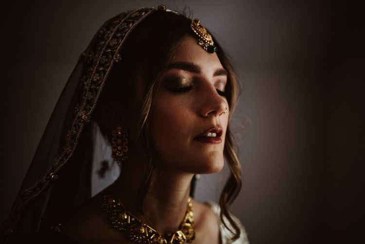 Bride in traditional Indian wedding dress and and bridal accessories
