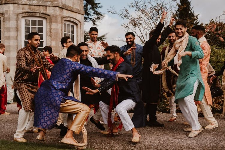 Indian wedding guests dancing outside Elmore Court
