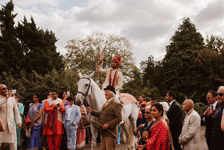 Indian groom's entry/jann on a white horse