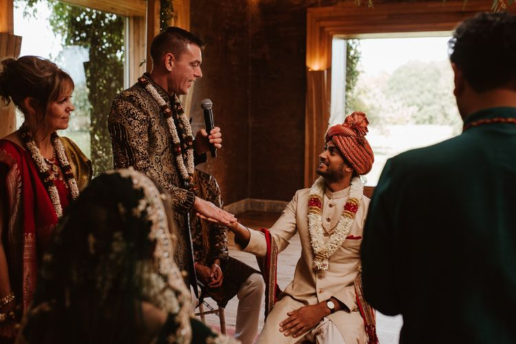 Bride's father shaking the grooms hand at Hindu wedding ceremony