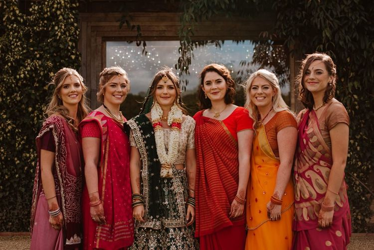 Bride and bridesmaids in colourful Indian sari's for Hindu and  civil wedding ceremony