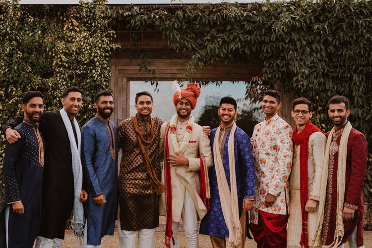 Groom and groomsmen in traditional Indian dress