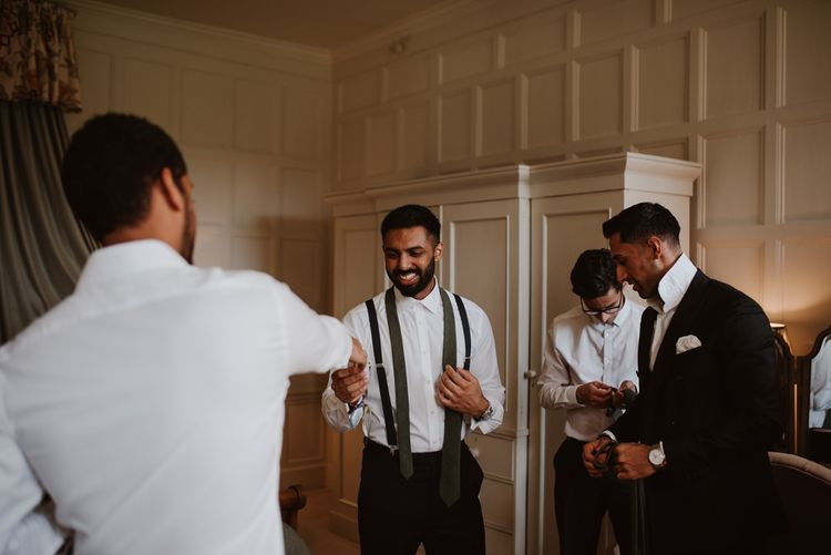 Groomsmen getting ready at Elmore Court for civil wedding ceremony