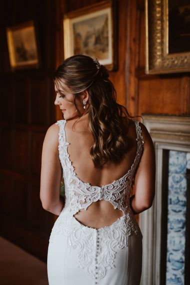 Wedding dress with low back and lace detail