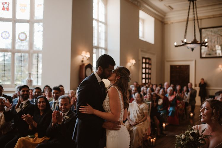 Bride and groom kissing at civil wedding ceremony