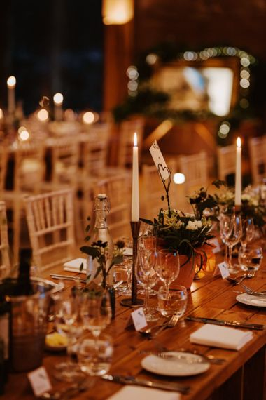 Elegant taper candles in gold candle sticks