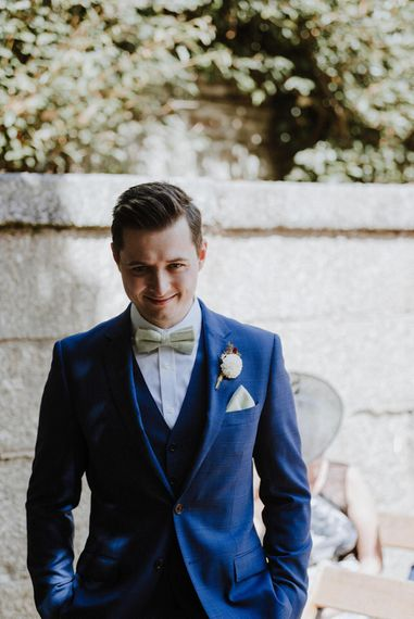 Groom in Hawes and Curtis Navy Suit & Bow Tie   Outdoor Cornish Wedding at Boconnoc Estate   Nick Walker Photography