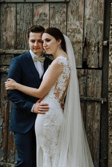 Bride in Lace Back Pronovias Wedding Dress   Groom in Hawes and Curtis Navy Suit & Bow Tie   Outdoor Cornish Wedding at Boconnoc Estate   Nick Walker Photography