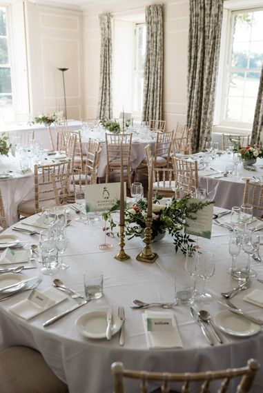 Floral Centrepiece by The Garden Gate Flower Company   Table Name Animal Illustrations by Dearly Beloved Wedding Stationery Designs   Outdoor Cornish Wedding at Boconnoc Estate   Nick Walker Photography