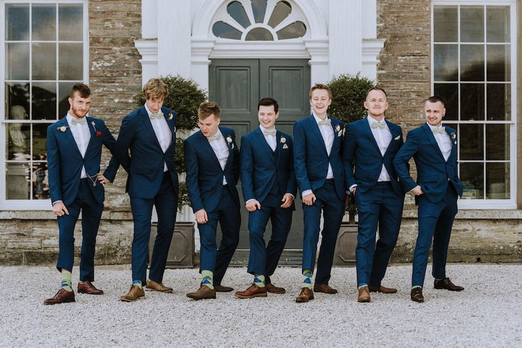 Groomsmen in Hawes and Curtis Navy Suits & Bow Ties   Outdoor Cornish Wedding at Boconnoc Estate   Nick Walker Photography