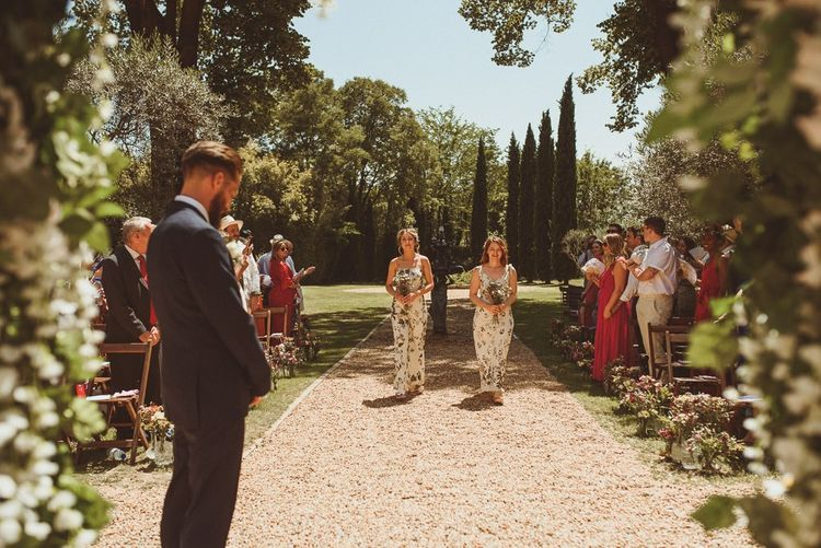 Bridesmaids Walk Down The Aisle For Outdoor Wedding