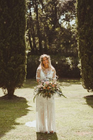 Bride With Bouquet and Flowercrown in Handmade Wedding Dress