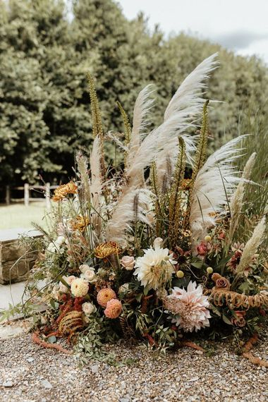 Boho floral arrangement with pampas grass and dahlias