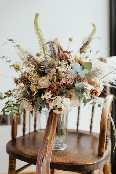 Romantic boho wedding bouquet with dried grasses