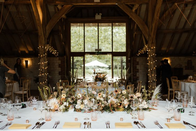 Top table wedding flowers at Bury Court Barn reception