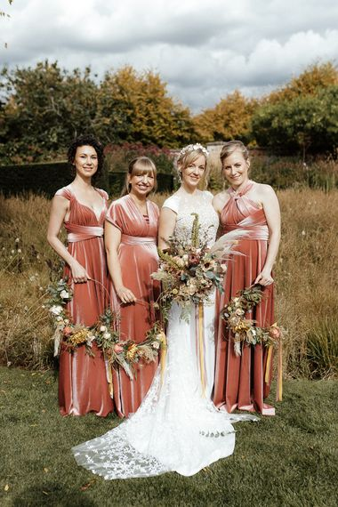 Bridal party portrait with bride in Rime Arodaky gown and bridesmaids in pink velvet dresses