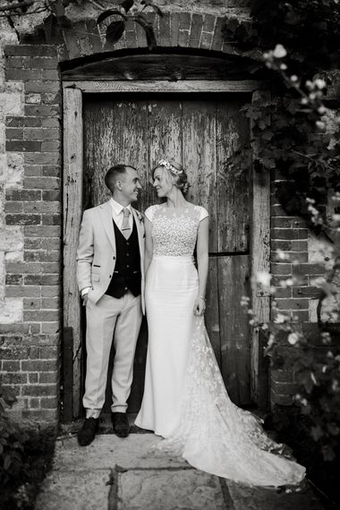Black and white portrait of the bride and groom at Bury Court Barn