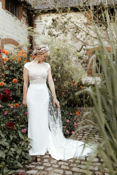 Bride in embroidered Rime Arodaky wedding dress with detailed bodice and train