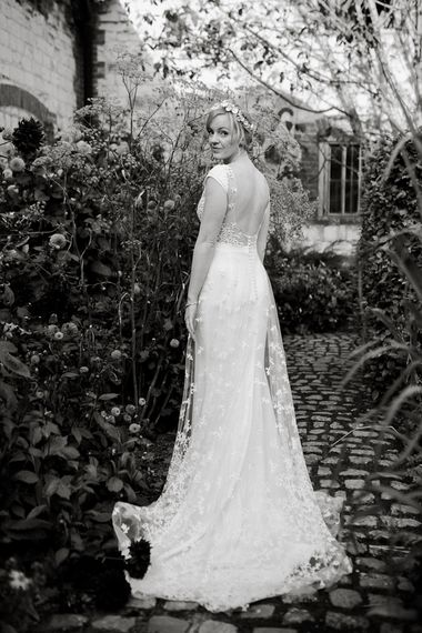 Bride in backless Rime Arodaky wedding dress with embroidered train