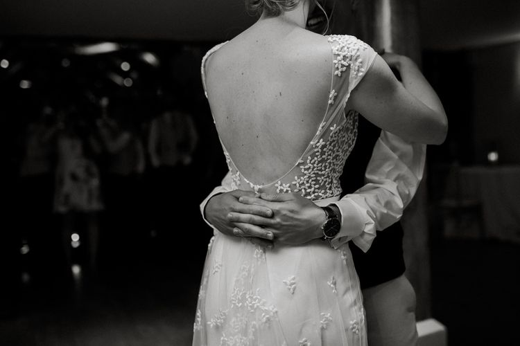 First dance with bride in backless Rime Arodaky wedding dress with embroidered detail