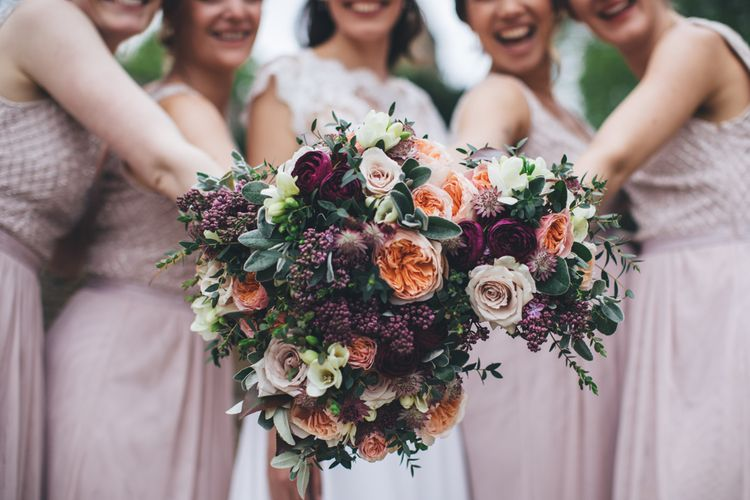 Military Wedding in Rutland Village with Marquee Reception filled with Swallows and Damsons Flowers | Jesús Peiró Bridal Gown | Pink Monsoon Bridesmaid Dresses | Mike Plunkett Photography