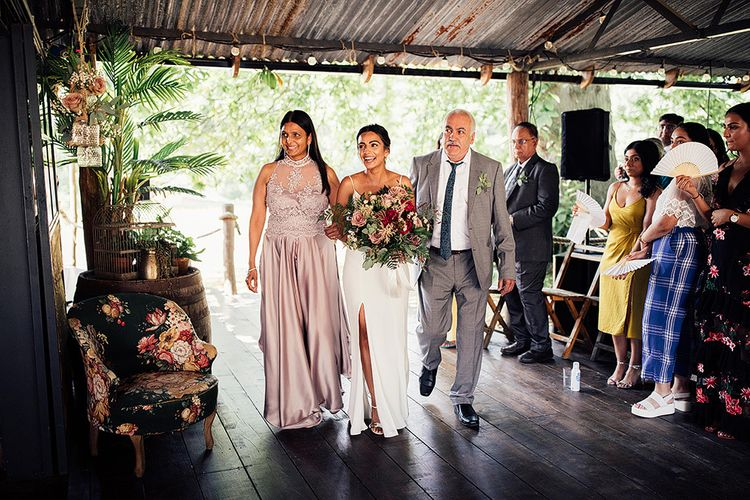 Bride Being Escorted Down the Aisle by Her Mum & Dad