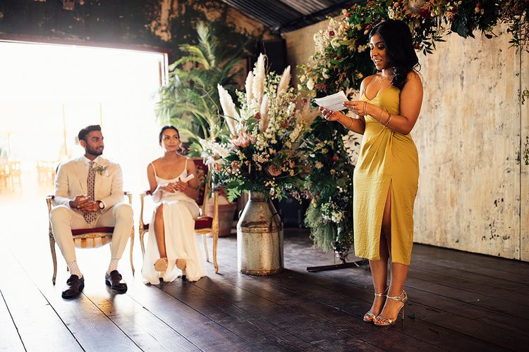 Bridesmaid in Yellow Dress Performing a Wedding Reading During the Ceremony