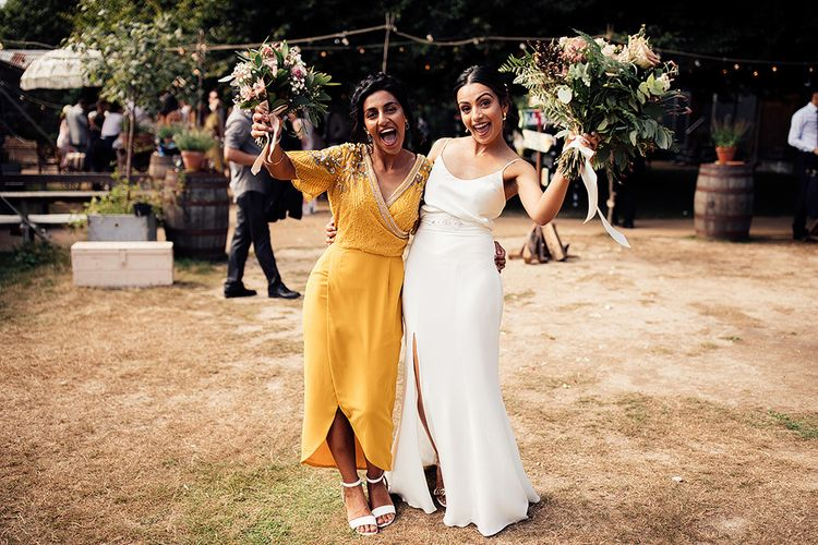 Bride in Spaghetti Belle & Bunty Wedding Dress and Bridesmaid in Yellow Sequin Dress