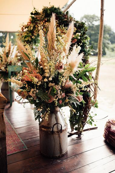 Milk Churn Wedding Flowers Filled with Dusky Pink Flowers, Foliage and Pampas Grass
