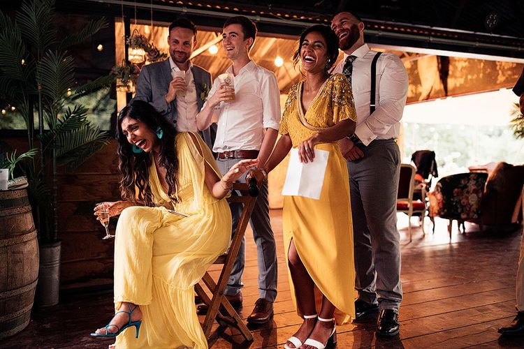 Wedding Guests in Yellow Dresses Laughing During the Wedding Speeches