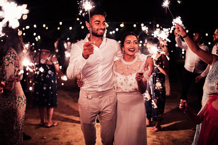Sparkler Moment with Bride in Belle & Bunty Wedding Dress and Embroidered Needle & Thread Top and Groom in Cream Trousers and White Shirt