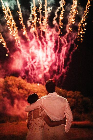 Bride in Belle & Bunty Wedding Dress and Embroidered Needle & Thread Top and Groom in Cream Trousers and White Shirt Watching the Fireworks