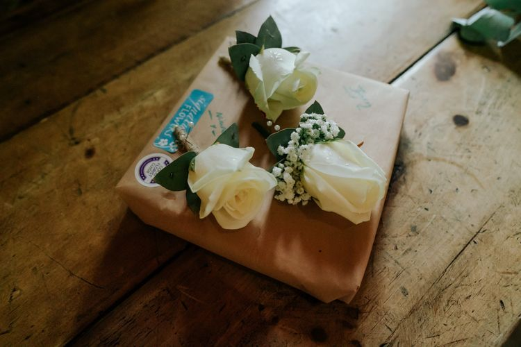White Wedding Flower Buttonholes To Compliment Pink Wedding Dress