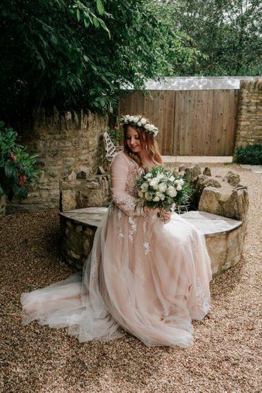 Bride In Pink Wedding Dress With White Wedding Flowers