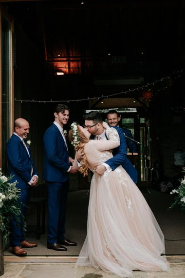 Bride and Groom Kiss After Vows