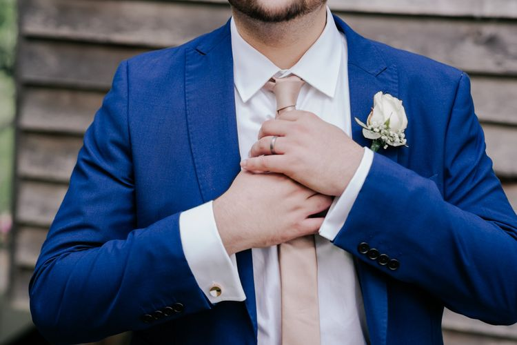 Blue Suit With Pink Accessories
