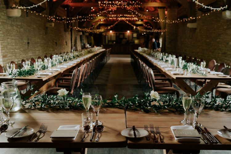 Tythe Barn Wedding Decor With White Flowers and Fairylights