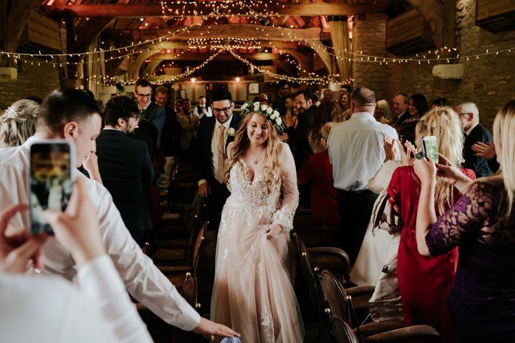 Bride  Enters Reception With Groom