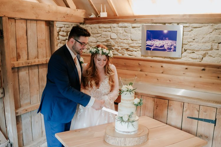 Bride and Groom Cut The Semi-Naked Wedding Cake