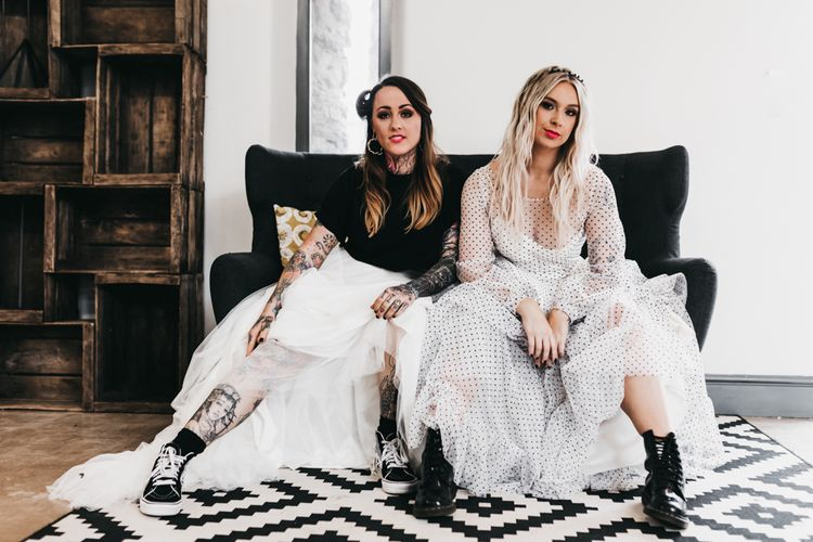 Same sex couple in polka dot black and white wedding dress and bridal separates