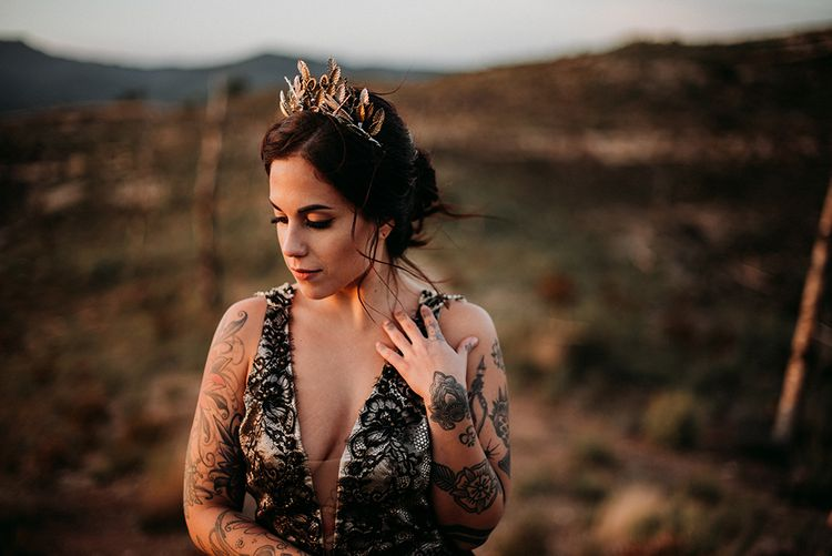 Bride in Black Lace Wedding Dress and Gold Crown Headpiece