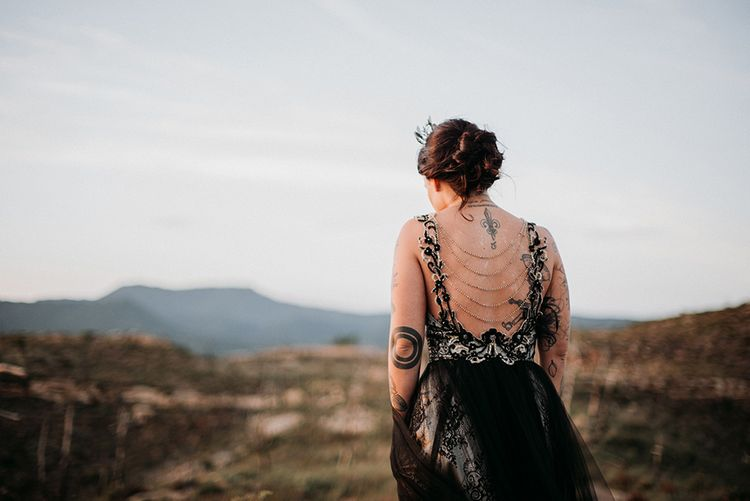Alternative Bride in Antonia Serena Atelier Wedding Dress with Black Lace and Chain Detailed Back