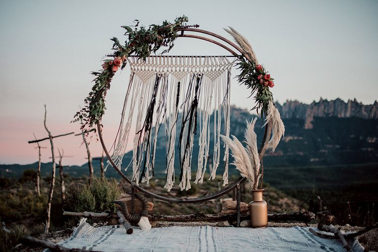 Steel Moon Gate Decorated with Macrame, Red Flowers, Foliage and Pampas Grass